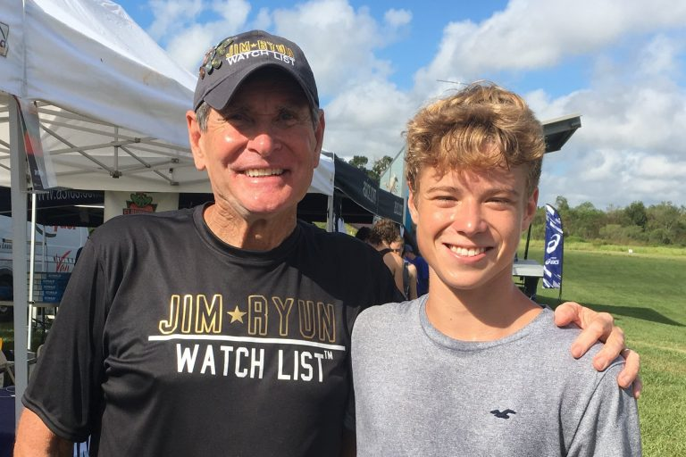 Photo of three-time ACRR camper and Jim Ryun